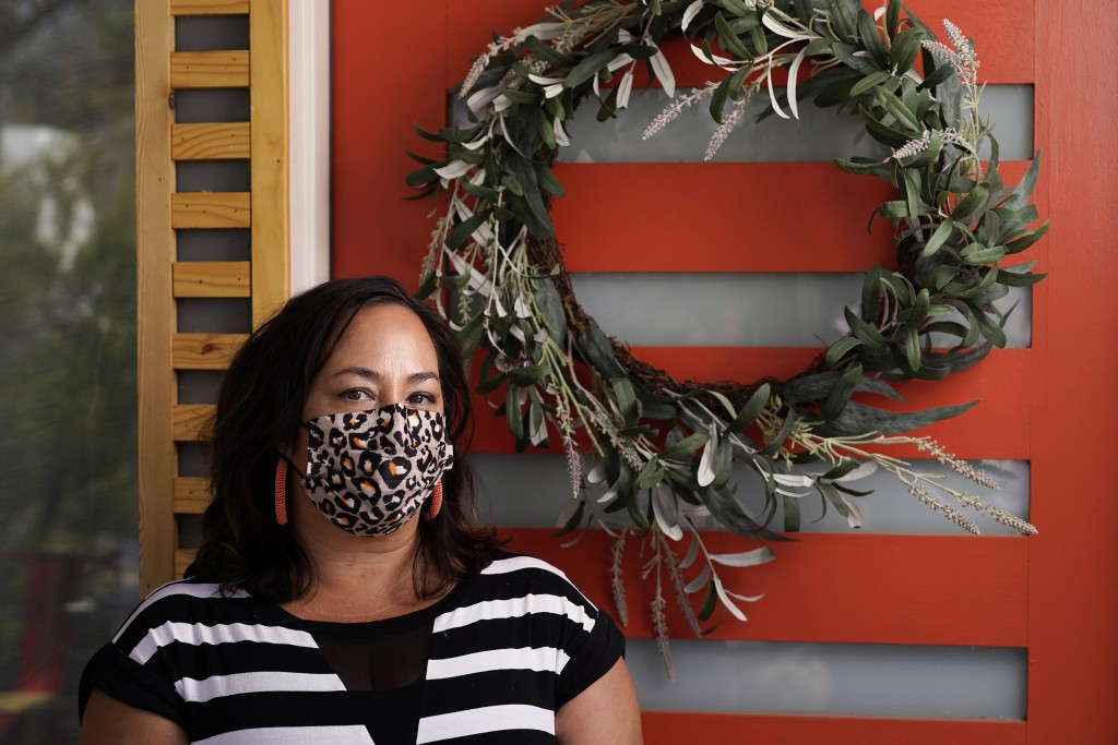 Lisa Phillips at her home Tuesday, April 20, 2021, in Phoenix. When the anniversary of the pandemic arrived, Phillips was not eager for a trip down me...