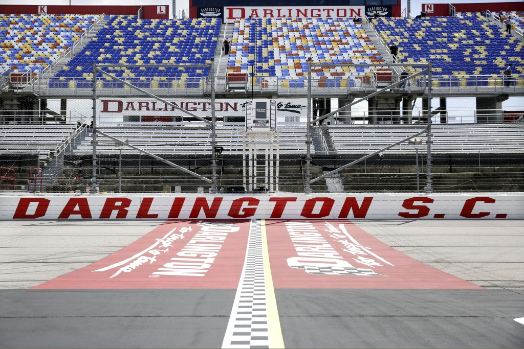 FILE - In this May 17, 2020, file photo, the grandstands are empty at Darlington Raceway before a NASCAR Cup Series auto race in Darlington, S.C. Darl...