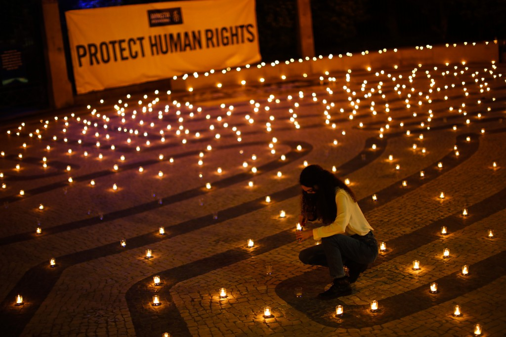 Amnesty International holds a vigil for Human Rights in India ahead of the EU-India Summit in Porto, Portugal, Thursday, May 6, 2021. European Union l...
