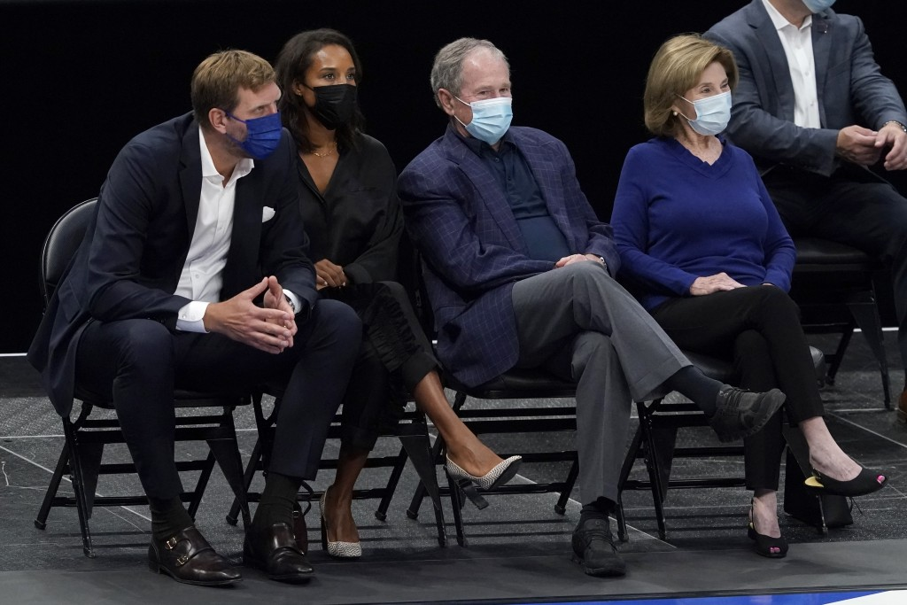 From left to right, former player Dirk Nowitzki, from left, his wife Jessica, former President George Bush and wife Laura Bush, watch as the Brooklyn ...