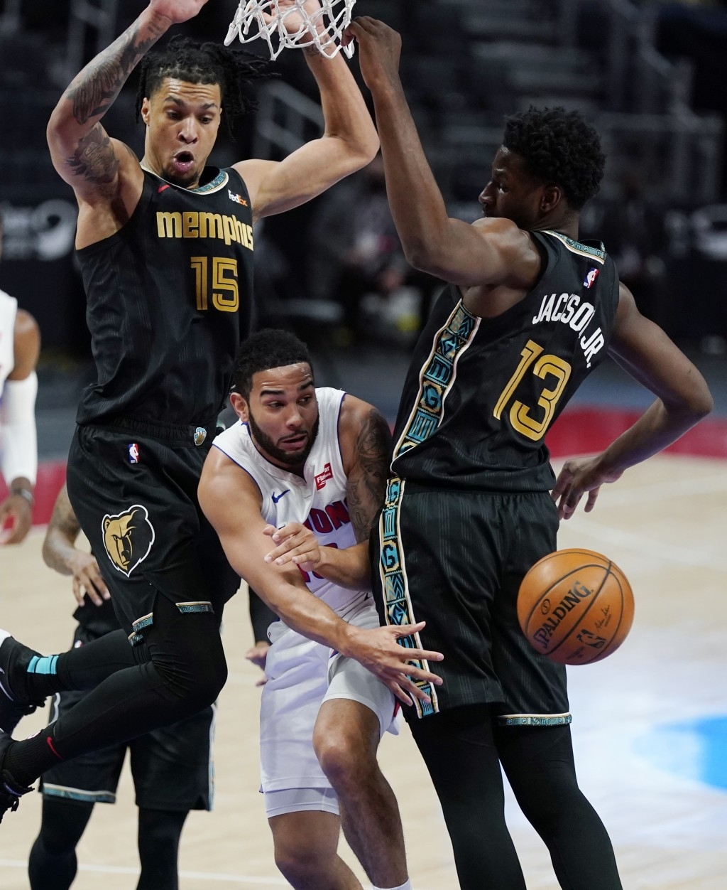 Detroit Pistons guard Cory Joseph passes as Memphis Grizzlies forward Brandon Clarke (15) and forward Jaren Jackson Jr. (13) defend during the first h...
