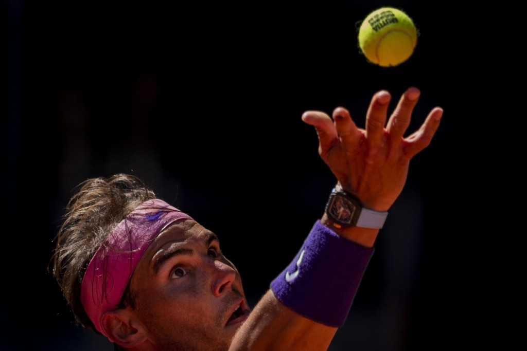 Spain's Rafael Nadal serves to Germany's Alexander Zverev during their match at the Mutua Madrid Open tennis tournament in Madrid, Spain, Friday, May ...