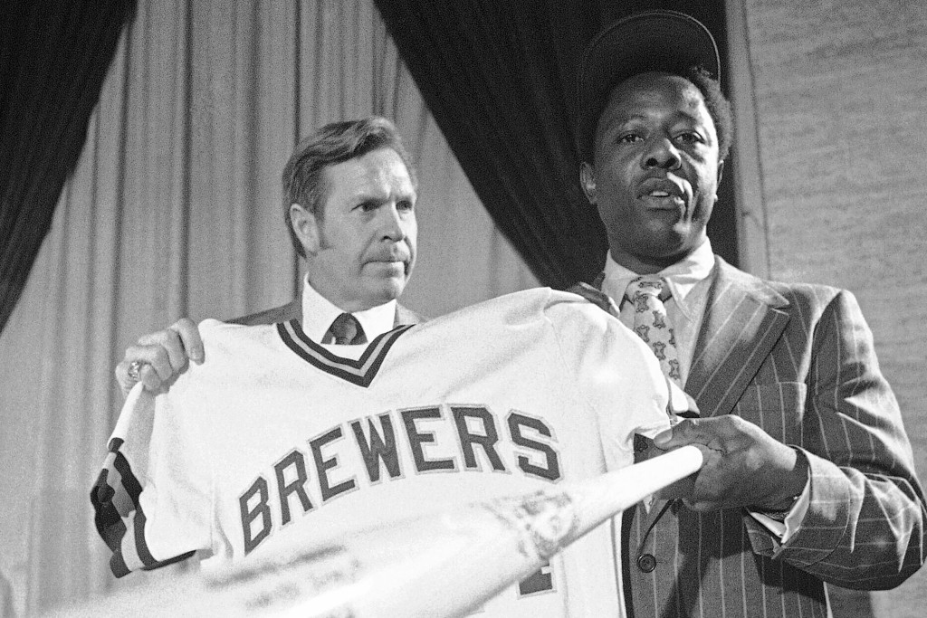 FILE - Milwaukee Brewers manager Del Crandall, left, and Henry Aaron display Aaron's new Brewers jersey and a bat during a news conference in Milwauke...