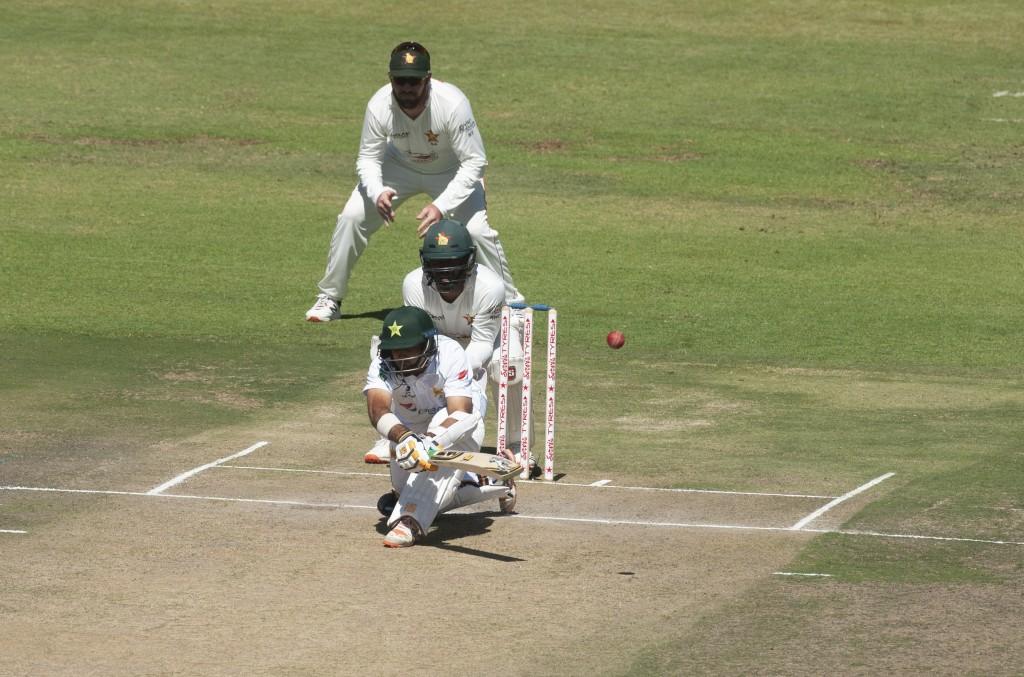 Pakistan batsman Abid Ali plays a shot during the second test cricket match against Zimbabwe at Harare Sports Club, Friday, May, 7, 2021.(AP Photo/Tsv...