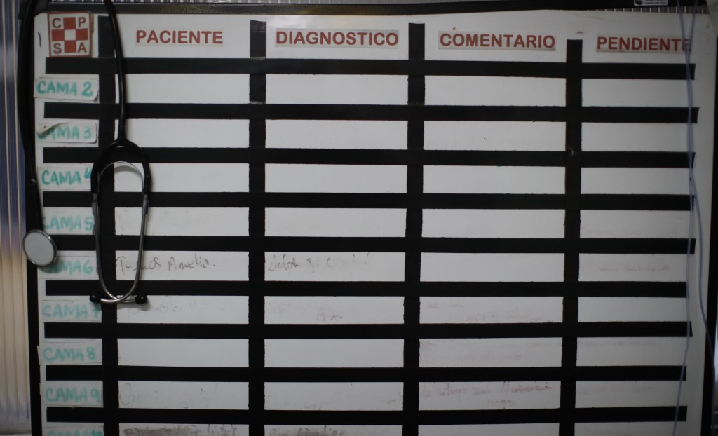 An empty white board hangs inside the ICU at the San Andres Clinic which has been occupied by its former workers since it closed at the start of the y...