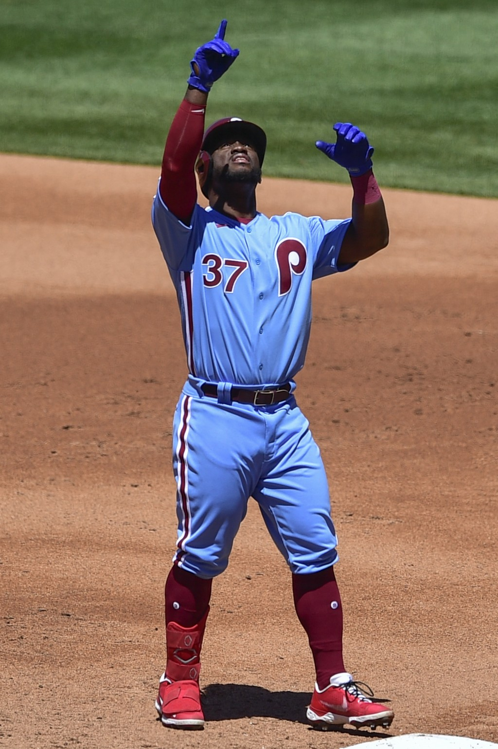Philadelphia Phillies' Odubel Herrera points to the sky after hitting a single off Milwaukee Brewers starting pitcher Brandon Woodruff during the seco...