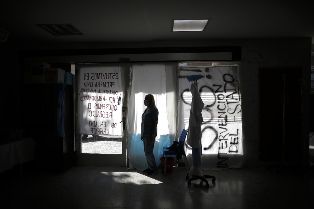 Nurse Lidia Del Valle stands inside San Andres Clinic which has been occupied by its former workers since it closed at the start of the year following...