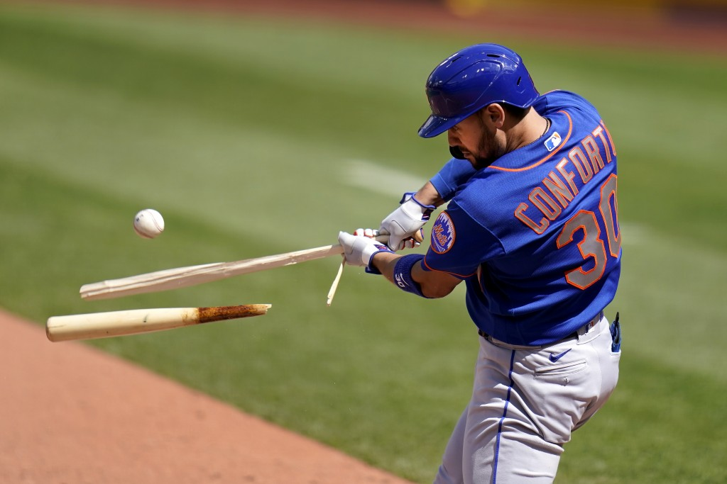 New York Mets' Michael Conforto hits a broken-bat single during the eighth inning of a baseball game against the St. Louis Cardinals Thursday, May 6, ...