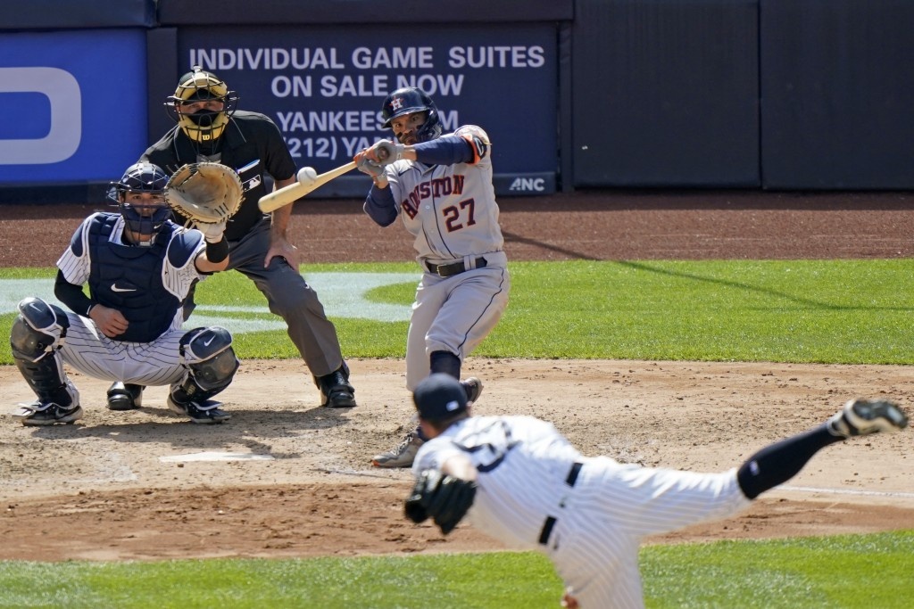 Houston Astros Jose Altuve (27) connects on an eighth-inning, three-run, home run off New York Yankees relief pitcher Chad Green in a baseball game, T...