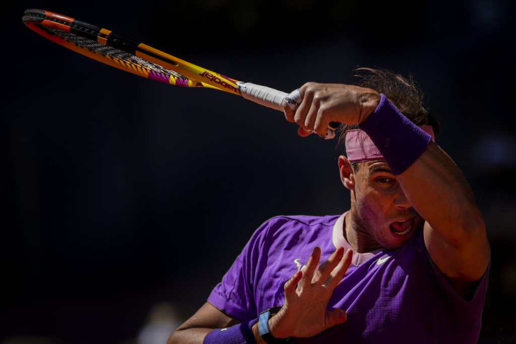 Spain's Rafael Nadal returns the ball to Germany's Alexander Zverev during their match at the Mutua Madrid Open tennis tournament in Madrid, Spain, Fr...