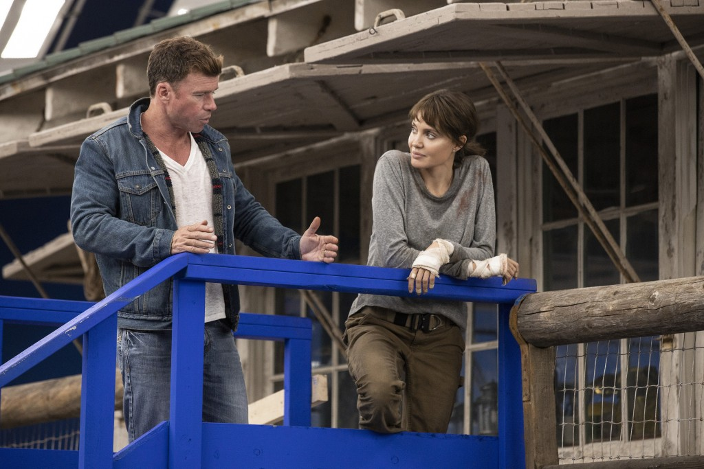 """This image released by Warner Bros. Entertainment shows director Taylor Sheridan, left, with Angelina Jolie on the set of """"Those Who Wish Me Dead."""" (E..."""