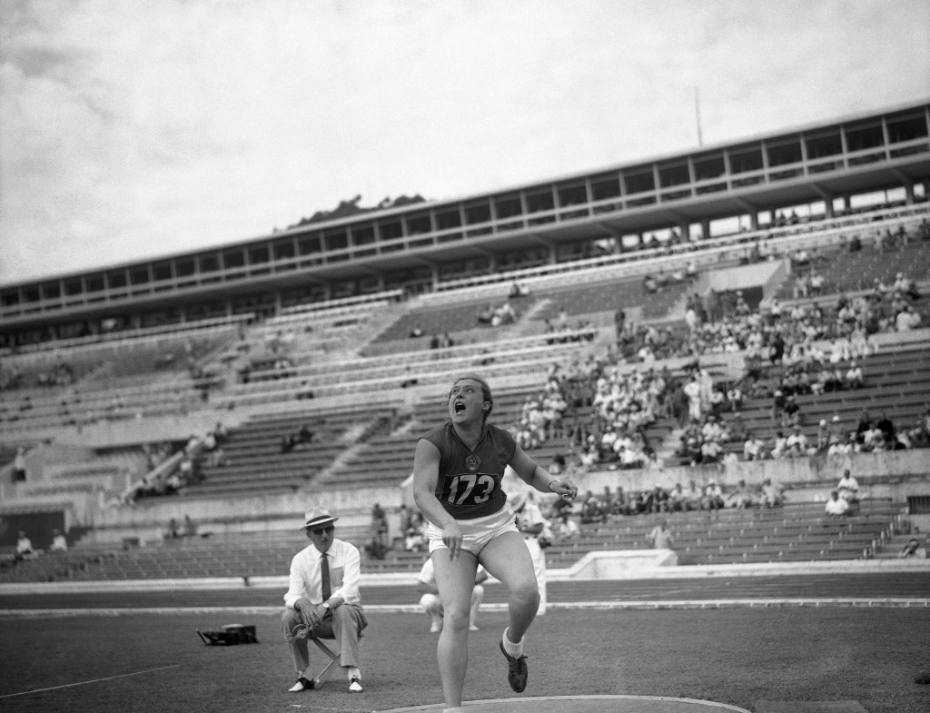 FILE - In this Sept. 2, 1960 file photo, Tamara Press of Russia heaves the shot during the Women's shot put qualifying round at the Summer Olympic Gam...