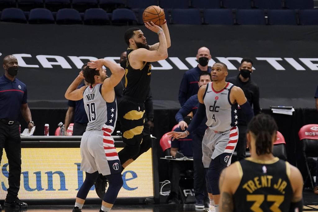 Toronto Raptors guard Fred VanVleet (23) shoots a three-point shot between Washington Wizards guard Raul Neto (19) and guard Russell Westbrook (4) tha...