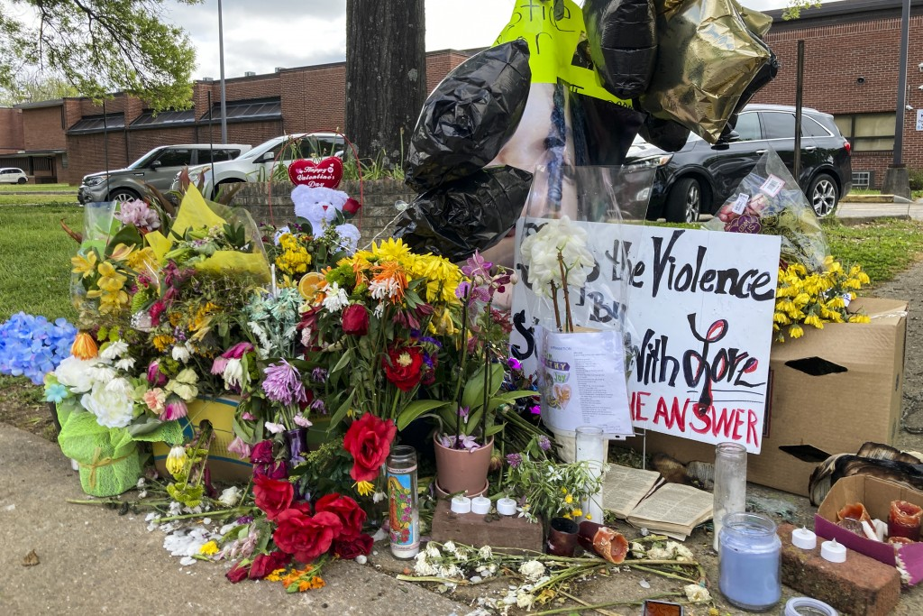 In this April 21, 2021 photo, a memorial is seen after a shooting at Austin-East Magnet High School, in Knoxville, Tenn. Members of the Black communit...
