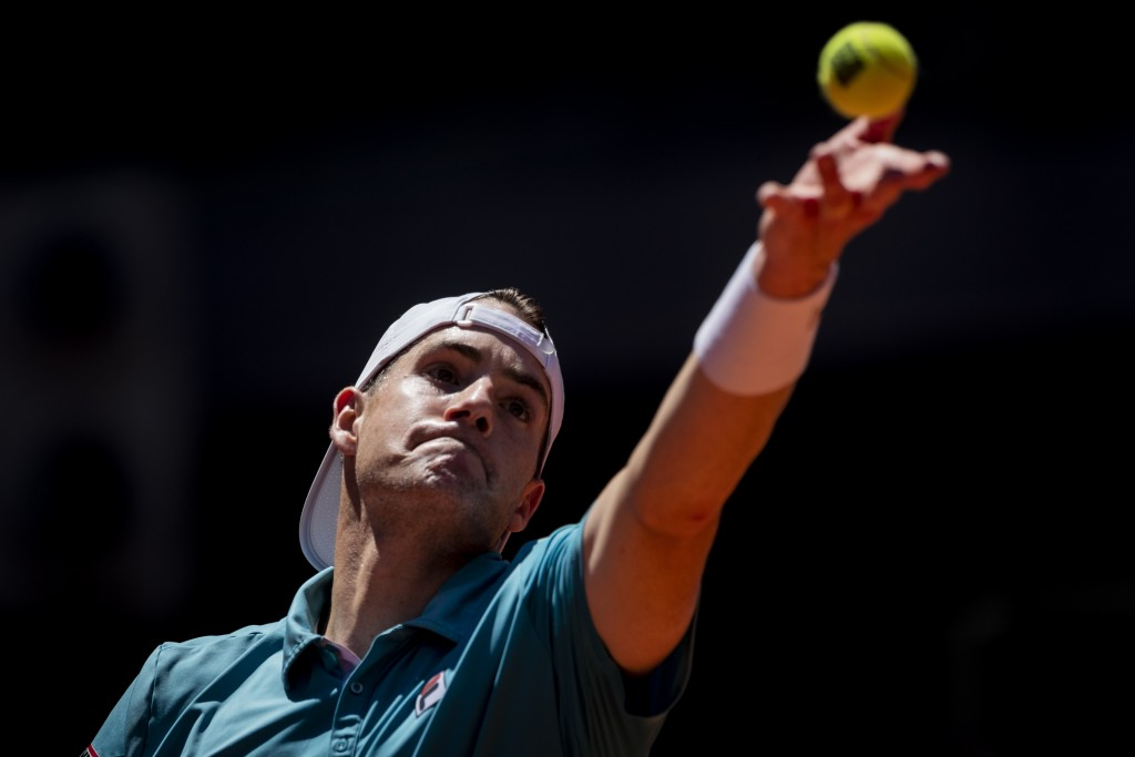 United States' John Isner serves to Austria's Dominic Thiem during their match at the Mutua Madrid Open tennis tournament in Madrid, Spain, Friday, Ma...