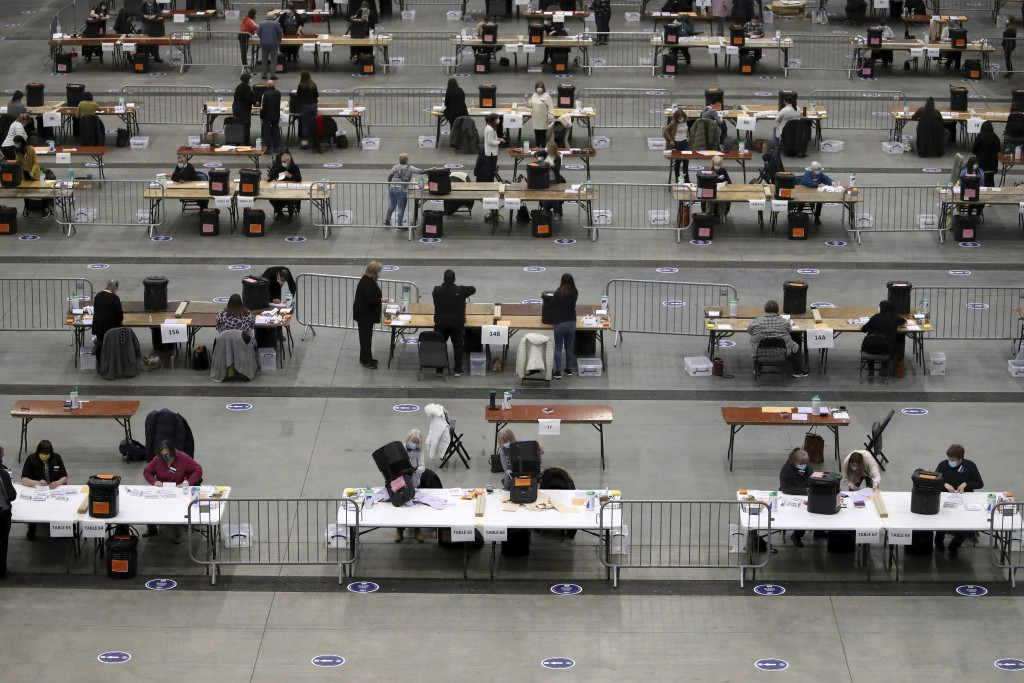 Socially distanced officials count votes for the Scottish Parliamentary Elections in Aberdeen, Scotland, Friday May 7, 2021.  The election is being wi...