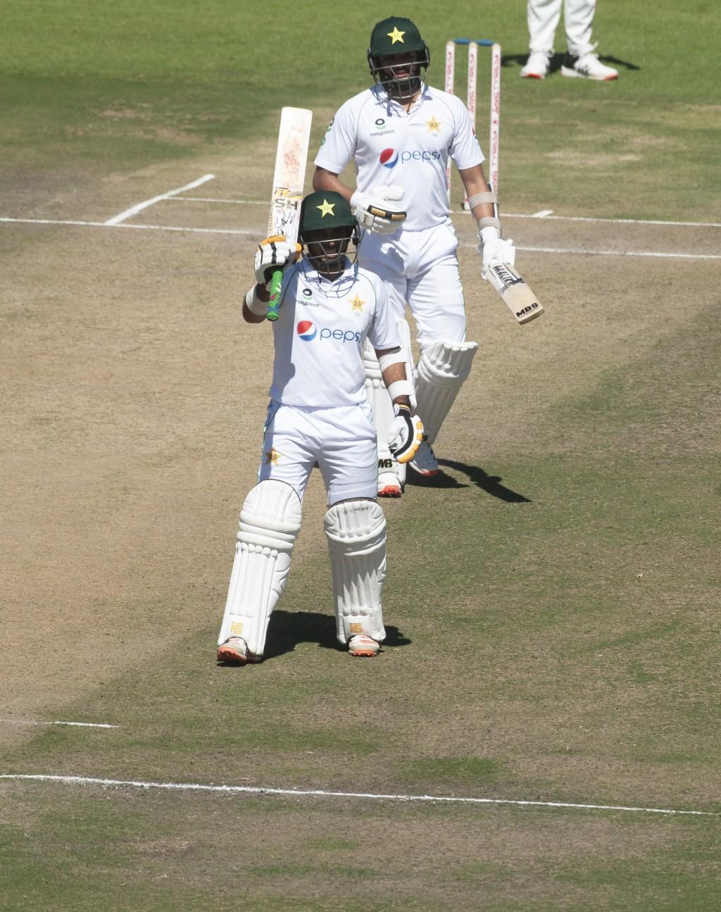 Pakistan batsman Abidi Ali celebrates after scoring 50 runs during the second test cricket match against Zimbabwe at Harare Sports Club, Friday, May, ...