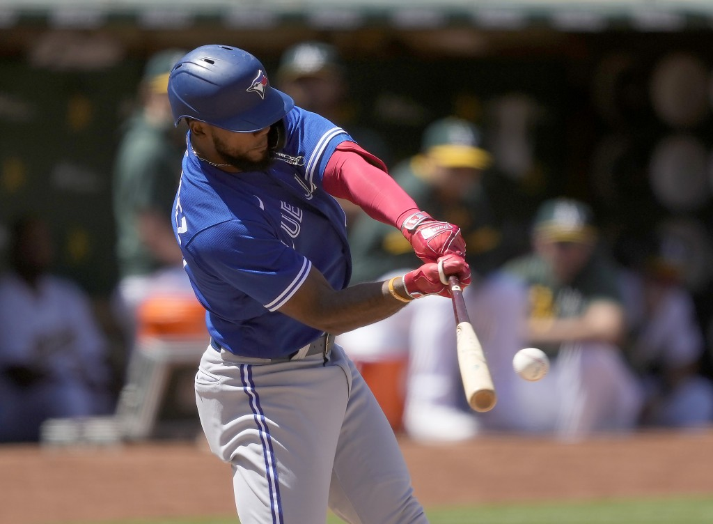 Toronto Blue Jays' Teoscar Hernandez (37) hits a single to drive in two runs against the Oakland Athletics during the sixth inning of a baseball game ...