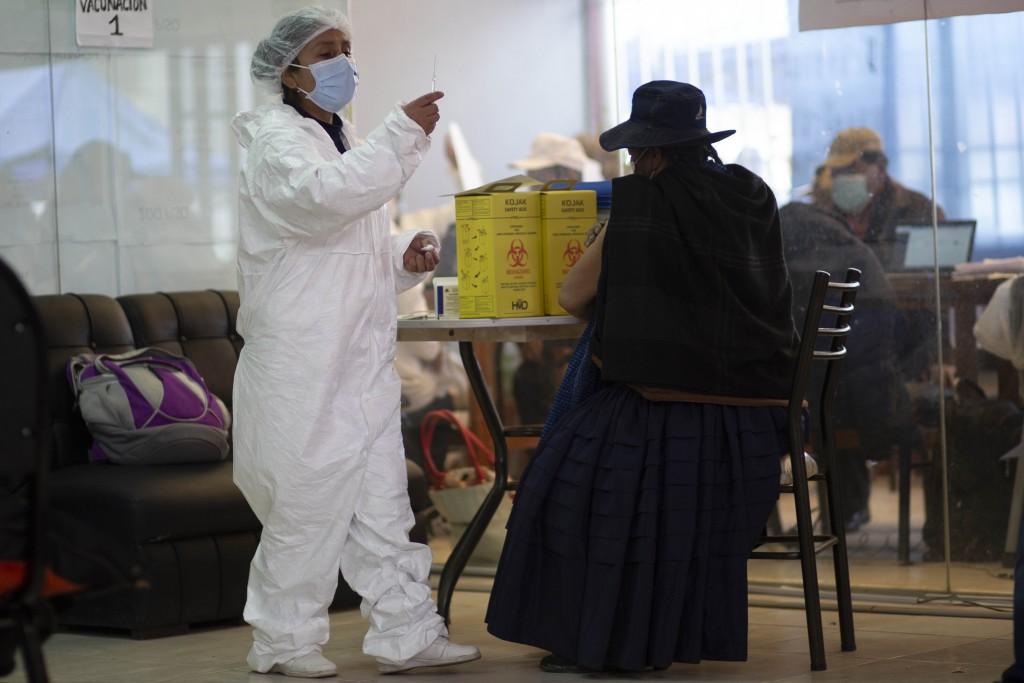A nurse prepares a shot of the Sputnik V COVID-19 vaccine at the Universidad Publica de El Alto, during a vaccination drive for people over age 60 in ...