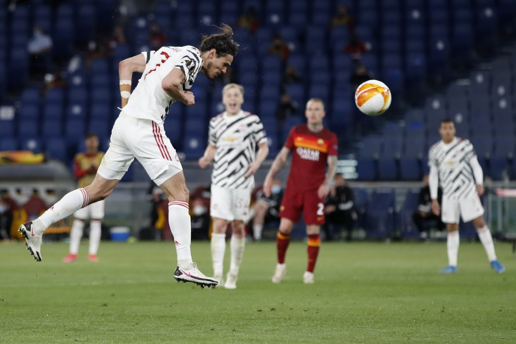 Manchester United's Edinson Cavani scores his side's second goal during the Europa League semifinal, second leg soccer match between Roma and Manchest...