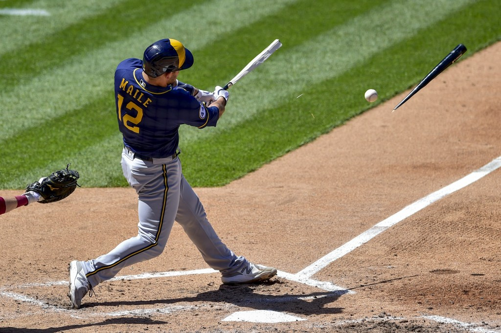 Milwaukee Brewers' Luke Maile breaks his bat on a ground ball out to Philadelphia Phillies' Alec Bohm during the sixth inning of a baseball game, Thur...