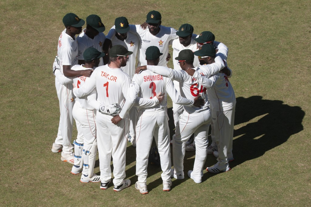 Zimbabwean players huddle together before going on the pitch during the second test cricket match against Pakistan at Harare Sports Club, Friday, May,...