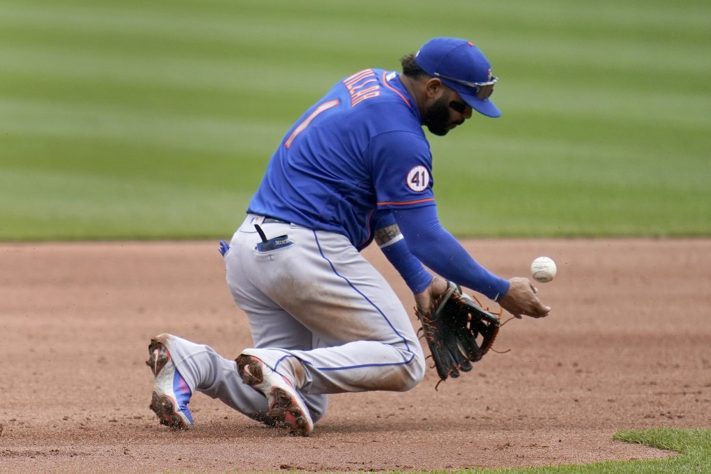 New York Mets third baseman Jonathan Villar stops a grounder by St. Louis Cardinals' Justin Williams before throwing Williams out at first during the ...