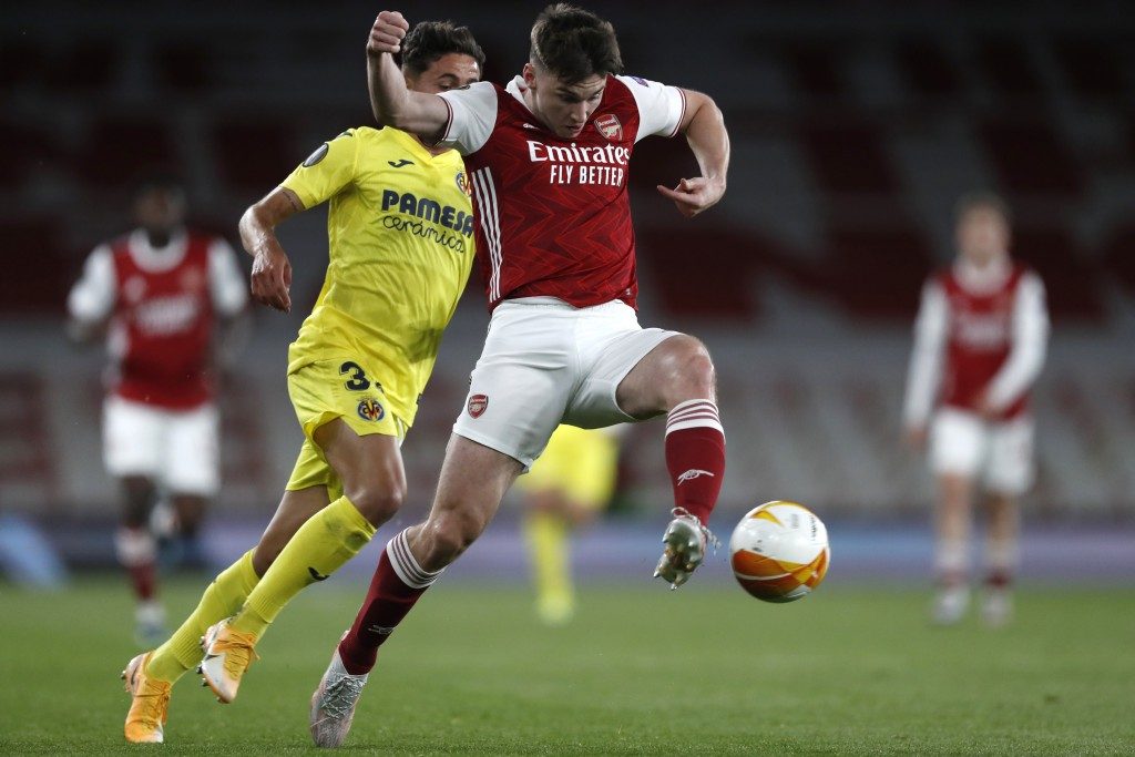Villareal's Yeremi Pino, left, and Arsenal's Kieran Tierney challenge for the ball during the Europa League semifinal second leg soccer match between ...