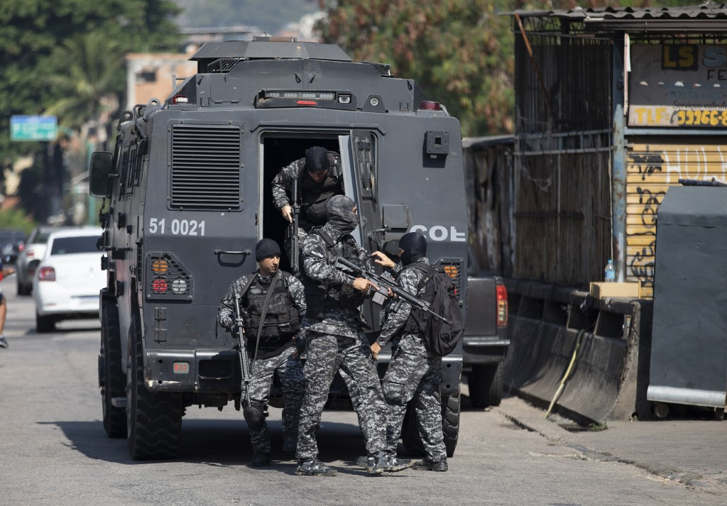 Police get out of an armored vehicle during an operation against alleged drug traffickers in the Jacarezinho favela of Rio de Janeiro, Brazil, Thursda...