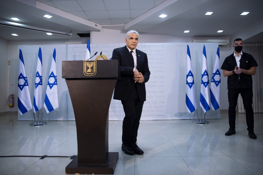 REPLACES COMMON GOOD INSTEAD OF COMMON GROUND - Israeli opposition leader Yair Lapid, poses for a photo during a news conference in Tel Aviv, Thursday...