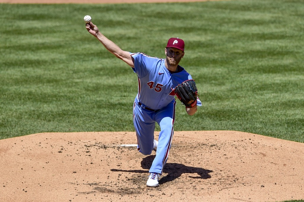 Philadelphia Phillies starting pitcher Zack Wheeler throws the ball during the third inning of a baseball game against the Milwaukee Brewers, Thursday...