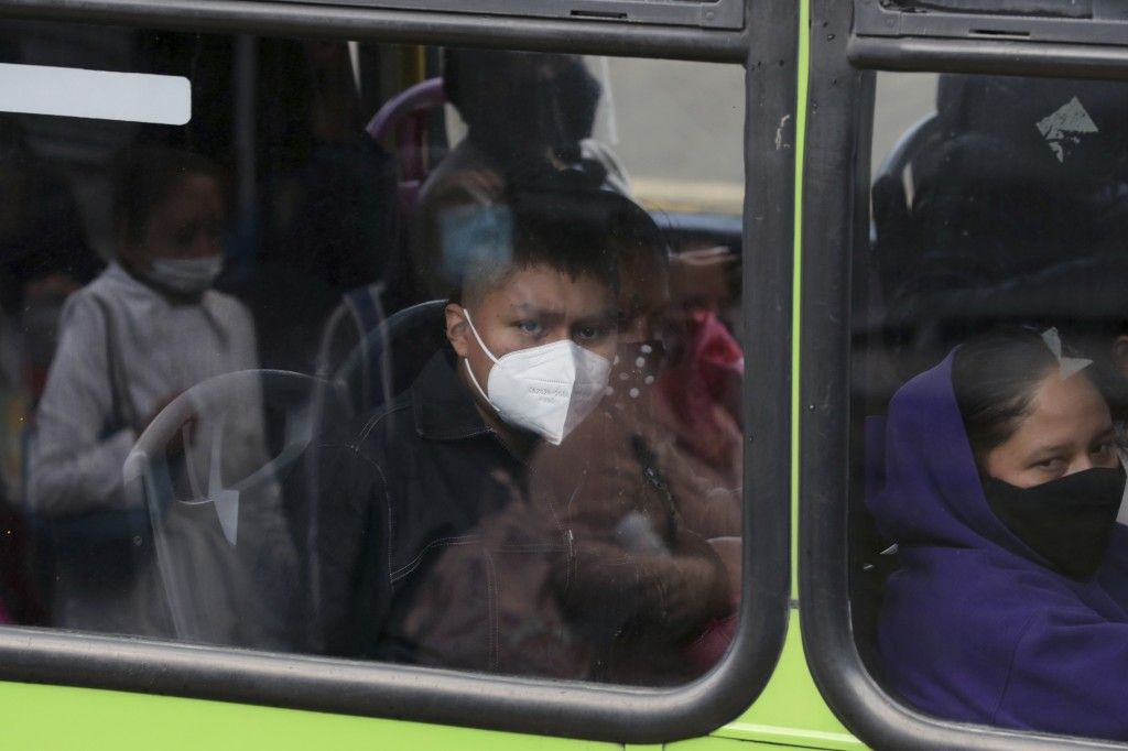 Left without subway service on Line 12 after Monday's collapse, commuters ride a bus on the south side of Mexico City, Thursday, May 6, 2021. At its f...