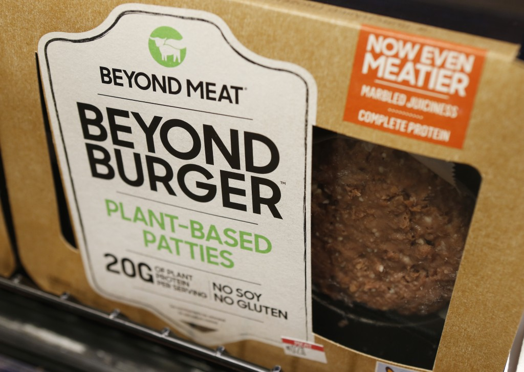 FILE - In this June 27, 2019, file photo, a meatless burger patty called Beyond Burger by Beyond Meat is displayed at a grocery store in Richmond, Va....