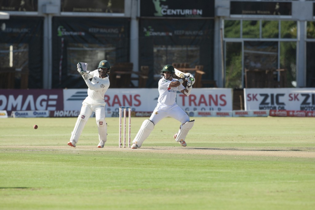 Pakistan batsman Abid Ali,right, plays a shot during the second test cricket match against Zimbabwe at Harare Sports Club, Friday, May 7, 2021.(AP Pho...