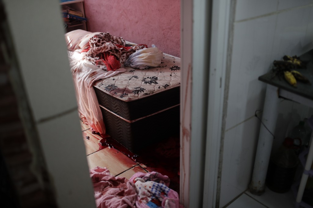 Blood covers the floor and a bed inside a home during a police operation targeting drug traffickers in the Jacarezinho favela of Rio de Janeiro, Brazi...
