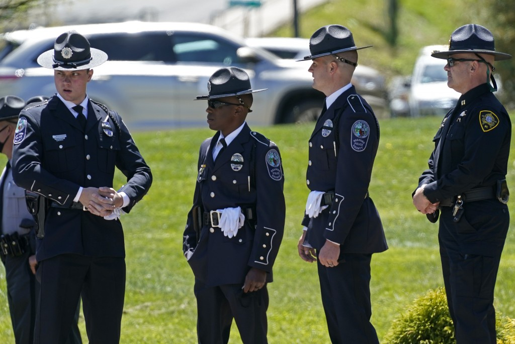 Law enforcement officer gather outside the Holmes Convocational Center for the funeral services of Watauga County Sheriff's Deputies Sgt. Chris Ward a...