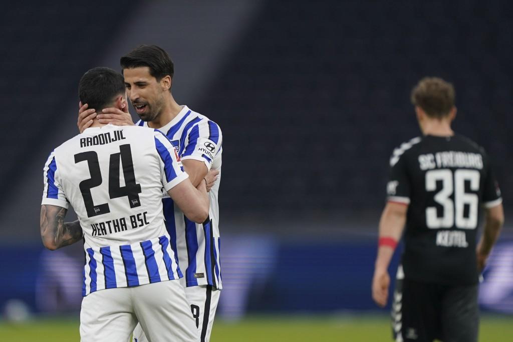 Berlin's Nemanja Radonjic, front left, celebrates after scoring his side's third goal during the German Bundesliga soccer match between Hertha BSC Ber...