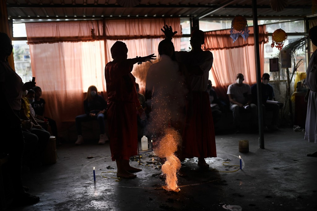 """Yaruby Mendoza is attended by healers Hermano Sebastian and Hermana Maria Cristina at the Lino Valles Spiritual Center, in an area known as """"The Alley..."""