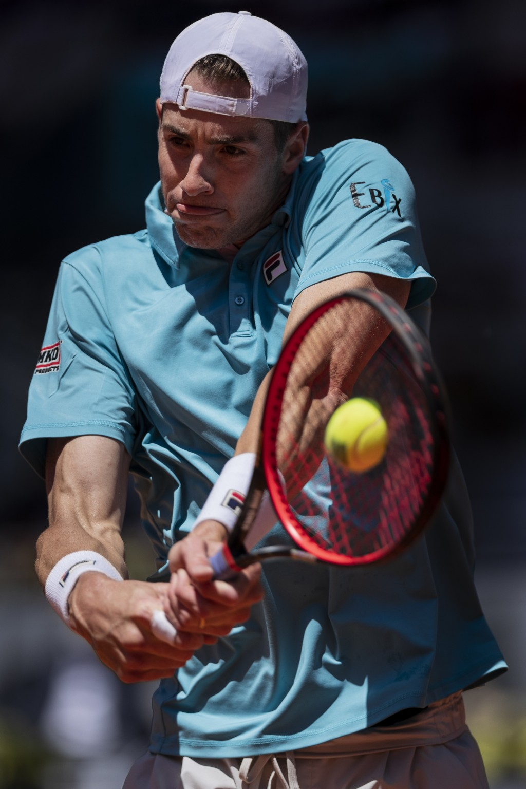 United States' John Isner returns the ball to Austria's Dominic Thiem during their match at the Mutua Madrid Open tennis tournament in Madrid, Spain, ...