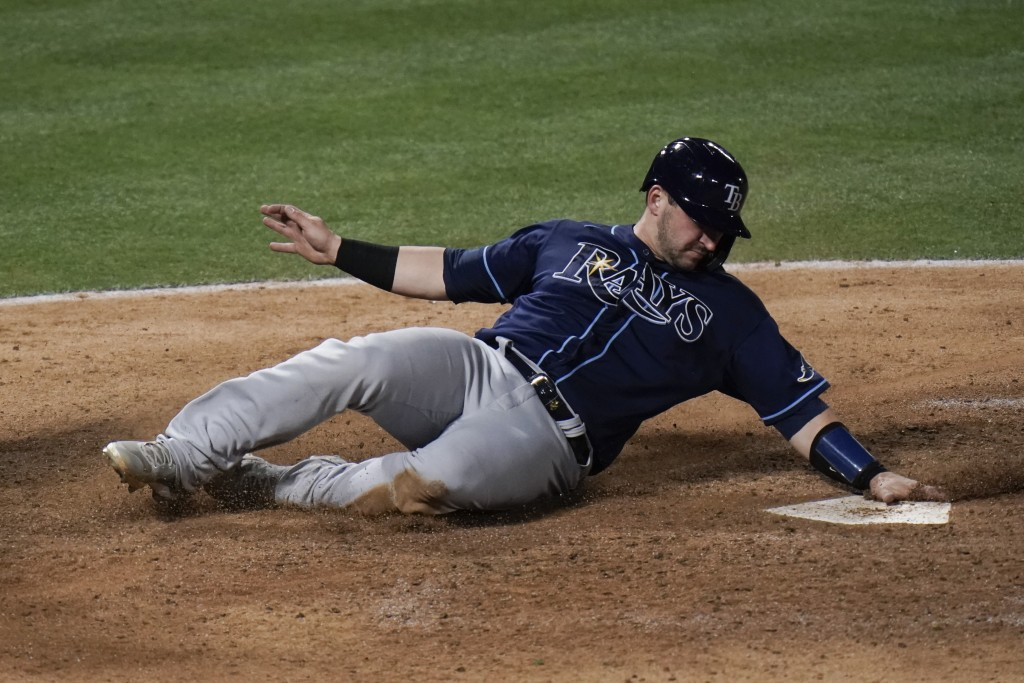 Tampa Bay Rays' Mike Zunino scores on a double by Brett Phillips during the eighth inning of the team's baseball game against the Los Angeles Angels, ...