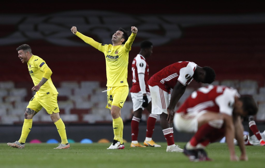 Villareal's Juan Foyth, left, and Villareal's Manu Trigueros, centre, celebrate at the end of the Europa League semifinal second leg soccer match betw...