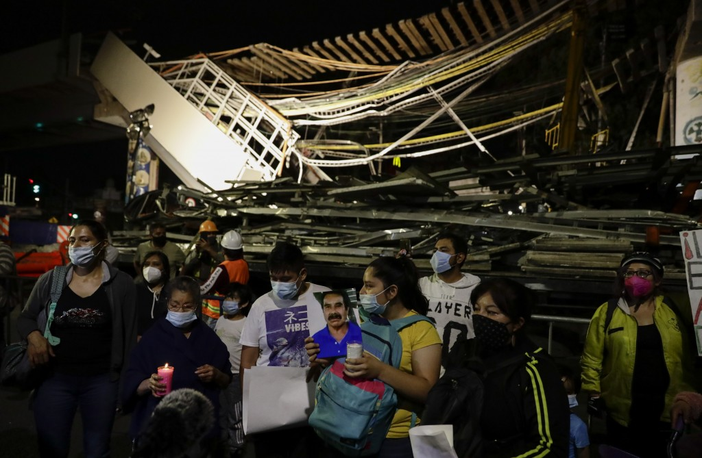 Family members protest demanding justice for the people who died in Monday's subway collapse, at the site of the wreckage in Mexico City's south side,...