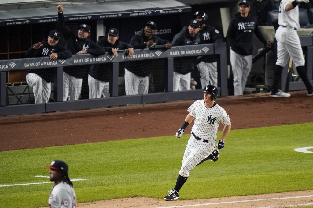 New York Yankees' DJ LeMahieu runs the bases after hitting a home run during the sixth inning of a baseball game against the Washington Nationals, Fri...