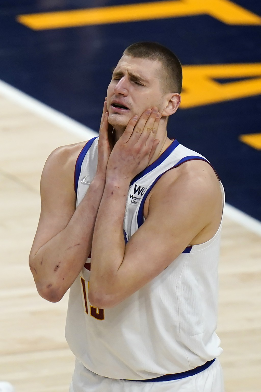 Denver Nuggets center Nikola Jokic reacts after fouling a Utah Jazz player during the first half of an NBA basketball game Friday, May 7, 2021, in Sal...