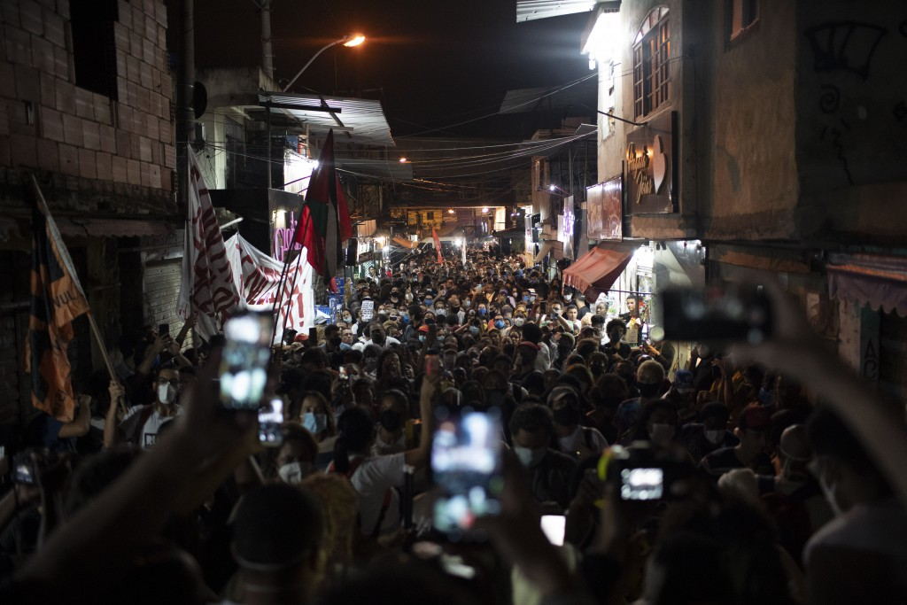 Relatives and residents protest a day after a deadly police operation in the Jacarezinho favela of Rio de Janeiro, Brazil, Friday, May 7, 2021. A bloo...