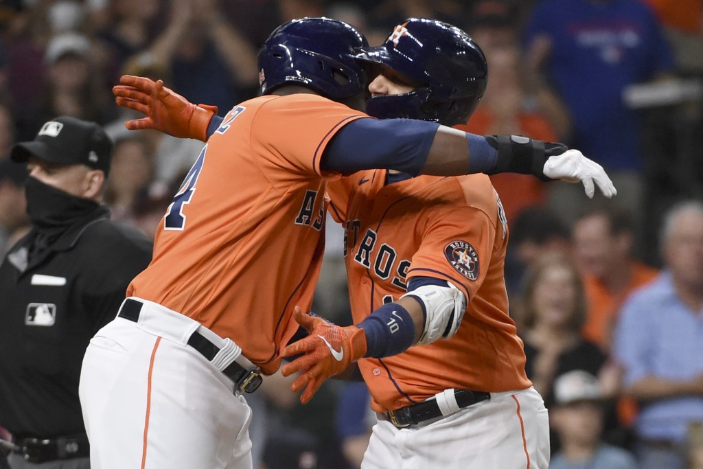 Houston Astros' Yuli Gurriel, right, celebrates his two-run home run with Yordan Alvarez during the fifth inning of baseball game against the Toronto ...