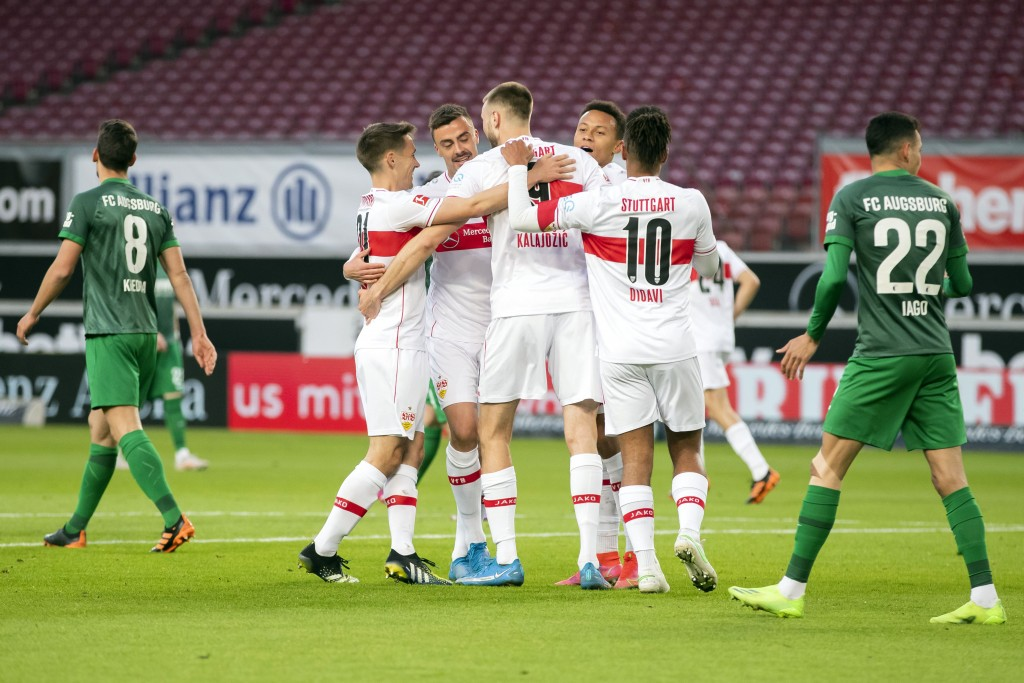 Stuttgart's Philipp Forster, 3rd left, celebrates scoring with teammates during the Bundesliga soccer match between VfB Stuttgart and FC Augsburg at t...