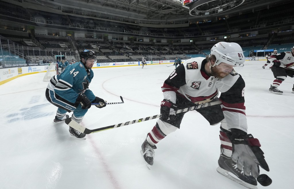 Arizona Coyotes right wing Phil Kessel (81) works for the puck against San Jose Sharks defenseman Marc-Edouard Vlasic (44) during the second period of...