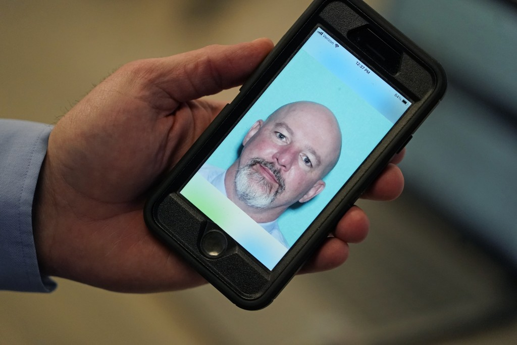 Ryan Williams, with the Utah Drivers License Division, holds his cell phone with the pilot version of the state's mobile ID on Wednesday, May 5, 2021,...