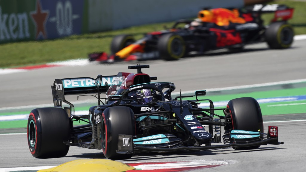 Mercedes driver Lewis Hamilton of Britain takes a curve followed by Red Bull driver Max Verstappen of the Netherlands, in the background, during the t...